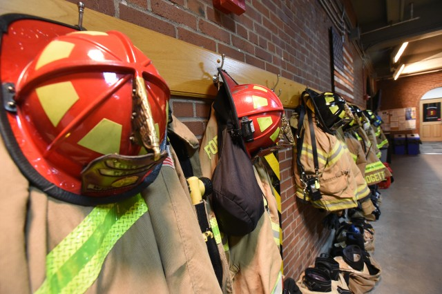 Firefighter hats hang from the engine bay in preparation for a fire at Fort Knox, much as they did 85 years ago at Bldg. 469, known as Fire Station No. 1.