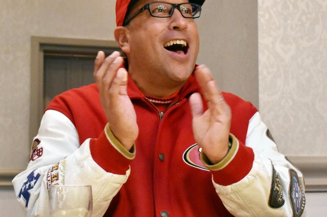 Robert Santana, a fitness specialist for Camp Zama Child and Youth Services, cheers for the San Francisco 49ers during the Super Bowl LIV party at the Camp Zama Community Club, Camp Zama, Japan, Feb. 3.
