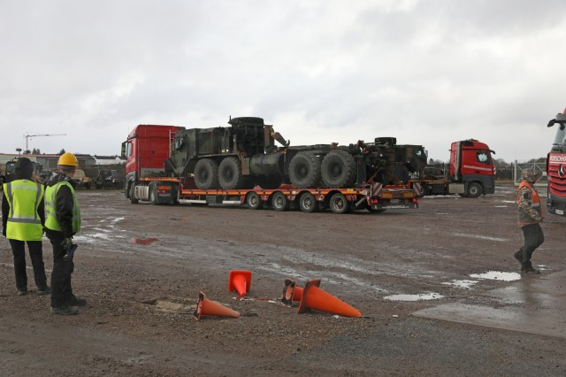 U.S. Army vehicles get transported by commercial line haul as part of an Army Prepositioned Stock (APS) movement at Coleman Barracks in Mannheim, Germany, Jan. 28, 2019. This APS movement is the first movement of equipment in support of DEFENDER-Europe 20.