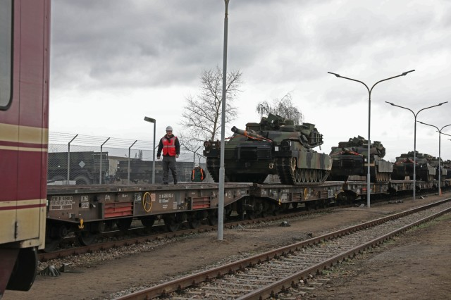 M1 Abrams vehicles get secured onto railcars as part of an Army Prepositioned Stock (APS) movement at Coleman Barracks in Mannheim, Germany, Jan. 29, 2019. This APS movement is the first movement of equipment in support of DEFENDER-Europe 20.