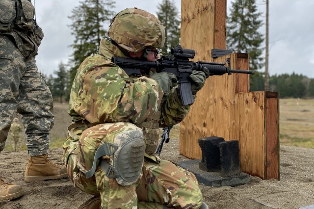 Spc. David Lange, a United States Army Reserve Legal Command Soldier, fires at a target during a qualification range at Joint Base Lewis-McChord, Washington, Jan. 13, 2020. (U.S. Army Reserve photo by Sgt. 1st Class Javier Orona)