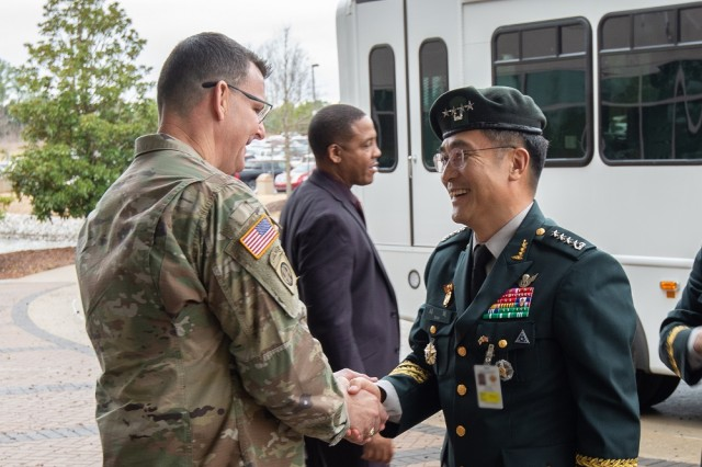 (From right) Gen. Wook Suh, right, Army chief of staff of the Republic of Korea, visits the U.S. Army Security Assistance Command, Jan. 15. During his visit to Redstone Arsenal, Suh met with USASAC Commander Gen. Jeffrey Druschal, left, to discuss the U.S.-ROK security assistance partnership. The South Korean senior military official was in the United States for talks with his U.S. counterpart Army Chief of Staff Gen. James McConville. During his weeklong visit, he also visited the Army Materiel Command, PEO Missiles and Space, and SMDC before traveling to the Army's Futures Command in Austin, Texas, to learn more about its advancement strategies. U.S.-Korean relations date back to the Joseon Dynasty with the 1882 Treaty of Peace, Amity, Commerce and Navigation, followed by the first U.S. diplomatic envoy to arrive in Korea in 1883. More than a century later, the U.S.-South Korean ties are based on a shared support of democracy, human rights and the rule of law.