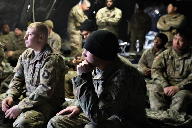 Soldiers of the 541st Transportation Company, 129th Division Sustainment Support Battalion, 101st Airborne Division (Air Assault) Sustainment Brigade, gather in a sleep tent after a long day of conducting base defense exercises to discuss the mission for the next day Jan. 22, at Fort Campbell, Ky.