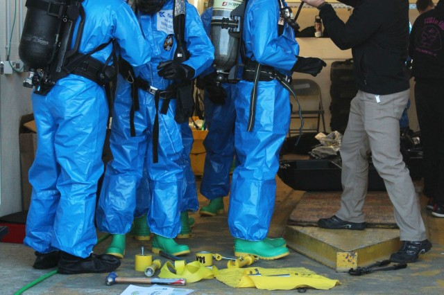Soldiers of the 720th Ordnance Company (Explosive Ordnance Disposal), 16th Special Troops Battalion, don on Level A Suites and Self Contained Breathing Apparatus equipment to train on the equipment as part of a two-week Chemical Biological Radiological and Nuclear (CRBN) Hazardous Material Technician Course at Baumholder, Germany. The 720th EOD is the first EOD unit to receive this course. (U.S. Army photo by: Staff Sgt. Sinthia Rosario, 16th Sustainment Brigade)