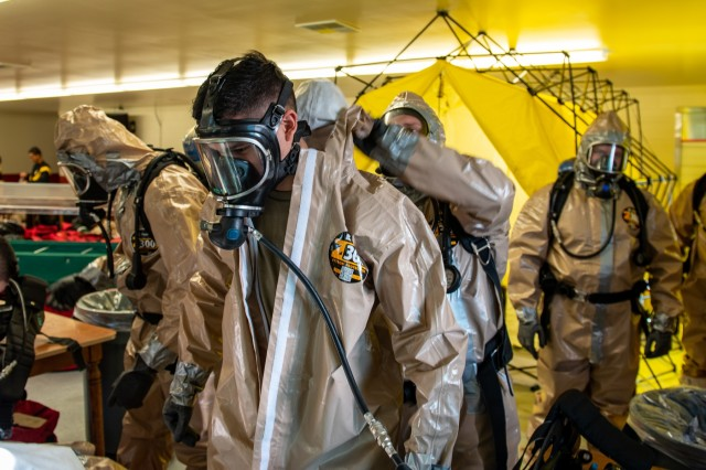 U.S. Army Pfc. Benjamin Ruehs with the 102nd CERFP, Oregon National Guard, finishes removing his hazmat suit after his simulated hasty decontamination at Camp Rilea near Warrenton, Oregon, January 26, 2020. The 102nd CERFP (Chemical, Biological, Radiological, Nuclear Enhanced Response Force Package) spent the weekend receiving training and certification in hazardous incident response.
