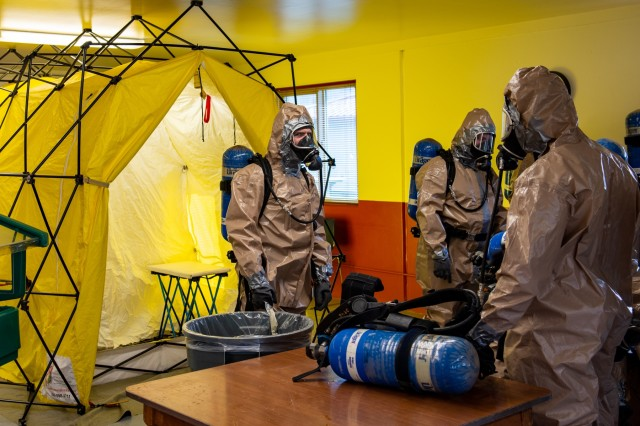 Soldiers with the 102nd CERFP, Oregon National Guard,  prepare to simulate the decontamination process while using self-contained breathing apparatus (SCBA) equipment, Camp Rilea, Oregon, Jan 26, 2020. The 102nd CERFP (Chemical, Biological, Radiological, Nuclear Enhanced Response Force Package) spent the weekend receiving training and certification in hazardous incident response.