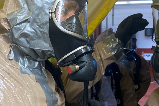 Spc. Melissa Benitez with the 102nd CERFP, Oregon National Guard, enters a hasty decontamination tent at Camp Rilea near Warrenton, Oregon, January 26, 2020. The 102nd CERFP (Chemical, Biological, Radiological, Nuclear Enhanced Response Force Package) spent the weekend receiving training and certification in hazardous incident response.