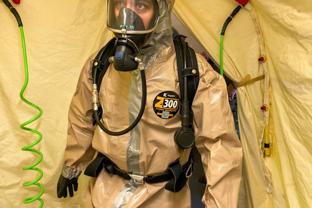 Spc. Melissa Benitez with the102nd CERFP, Oregon National Guard, enters a hasty decontamination tent at Camp Rilea near Warrenton, Oregon, January 26, 2020. The 102nd CERFP (Chemical, Biological, Radiological, Nuclear Enhanced Response Force Package) spent the weekend receiving training and certification in hazardous incident response.