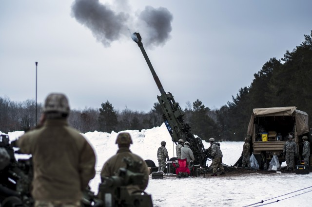 "U.S. Army soldiers from C Battery, 1st Battalion, 120th Field Artillery Regiment, Wisconsin Army National Guard conduct a Fire Control Alignment Test (FCAT) to ensure the M777A2 155mm howitzers are properly aligned to provide an accurate fire mission at Camp Grayling, Mich., during joint training exercise Northern Strike 20-2 (""Winter Strike,"") January 24, 2020."