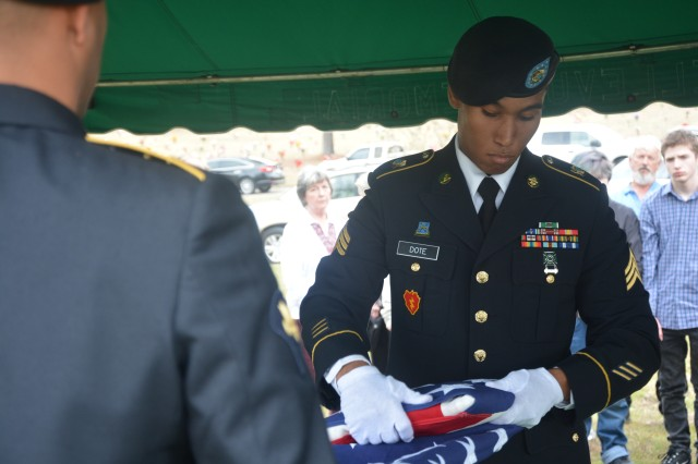 Sgt. David Dote, an intelligence analyst, folds the flag of a deceased Veteran during a burial service held at Bellevue Memorial Gardens in Grovetown on Feb. 5.