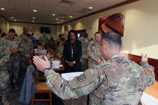 Battalion Chaplain (Capt.) Jae Chang, 2-6th ADA, performs the benediction to close the ceremony.  The prayer meals are part of the battalion's resiliency efforts for its Soldiers and cadre, Chang said.