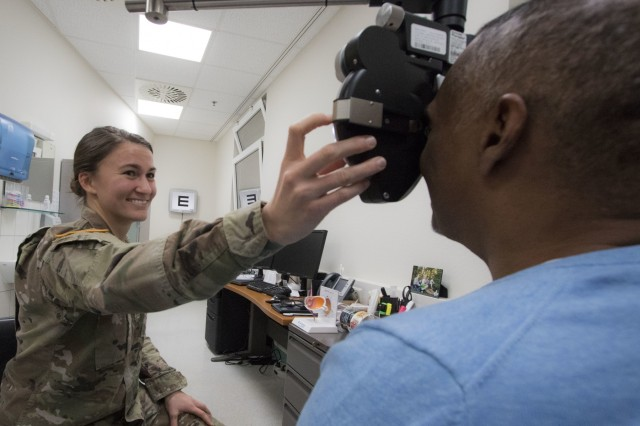 U.S. Army Capt. Shannon Kirchmer, an optometrist at Landstuhl Regional Medical Center's Optometry Clinic, uses a phoropter to determine eyeglass prescription for a patient at LRMC's Optometry Clinic, Feb. 4. Landstuhl Regional Medical Center's Optometry Clinic offers services to active-duty service members, their eligible family members, retirees and their eligible family members, and federal employees on a space-available basis.