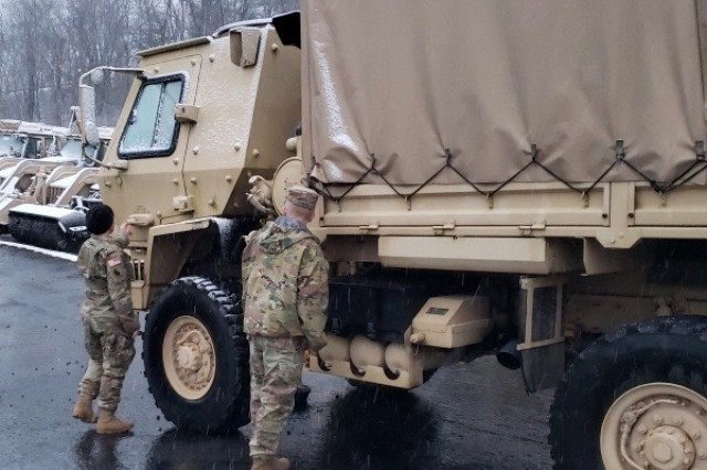 Virginia National Guard Soldiers assigned to the Cedar Bluff-based 1033rd Engineer Company, 276th Engineer Battalion, 329th Regional Support Group conduct maintenance checks on their light/medium tactical truck Feb. 7, 2020, in Cedar Bluff, Virginia.