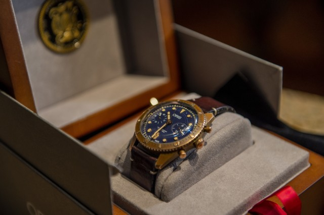 """A limited-edition Swiss watch rests in a display case in honor of Carl Brashear, the first African-American master diver in U.S. Navy's history who lost his leg during a tragic accident on a diver mission off the coast of Spain in 1966. Carl Brashear's life story about overcoming physical and racial adversity was featured in the Hollywood film """"Men of Honor"""" starring Cuba Gooding Jr. and Robert De Niro. Phillip Brashear has more than 38 years of military service between the U.S. Navy Reserve, the U.S. Army National Guard and the U.S. Army Reserve. He spent the majority of his Army career as a helicopter pilot with deployments to Bosnia and Iraq."""