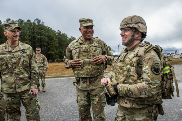 """Chief Warrant Officer 4 Phillip Brashear (center), a U.S. Army Reserve command chief warrant officer for the 80th Training Command, jokes around with Chief Warrant Officer 5 Hal Griffin, the U.S. Army Reserve command chief warrant officer, before taking part in a foot march with warrant officer candidates attending the Regional Training Institute at Fort Pickett, Va., Jan. 25, 2020. Brashear is a helicopter pilot with combat experience and the son of Carl Brashear, the first African-American master diver in U.S. Navy's history who lost his leg during a tragic accident on a diver mission off the coast of Spain in 1966. Carl Brashear's life story about overcoming physical and racial adversity was featured in the Hollywood film """"Men of Honor"""" starring Cuba Gooding Jr. and Robert De Niro. Phillip Brashear has more than 38 years of military service between the U.S. Navy Reserve, the U.S. Army National Guard and the U.S. Army Reserve. He spent the majority of his Army career as a helicopter pilot with deployments to Bosnia and Iraq."""