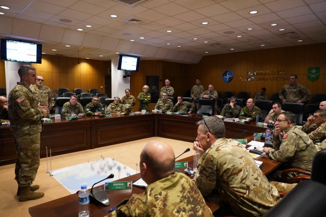 """U.S. Army Col. Larry V. Geddings, Jr., Director, Joint and Army Concepts, briefs select senior staff representatives from LANDCOM, NATO Rapid Deployable Corps Italy, and NATO Rapid Deployable Corps Greece on the Multi-Domain Operations Concept. He and his team from U.S. Army Futures Command led MDO discussions as part of a week of """"academics"""" at NATO Allied Land Command in Izmir, Turkey, designed to educate and prepare the staff on Multi-Corps Land Component Command operations in preparation for Exercise Trident Jupiter 19-2."""