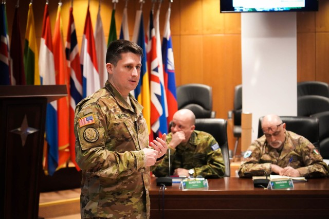 """U.S. Army Lt. Col. Wilson Blythe, Jr., Battlefield Development Plans Chief for Army Futures and Concepts Center, briefs select senior staff representatives from LANDCOM, NATO Rapid Deployable Corps Italy, and NATO Rapid Deployable Corps Greece on the Multi-Domain Operations Concept. He and his team from U.S. Army Futures Command led MDO discussions as part of a week of """"academics"""" at NATO Allied Land Command in Izmir, Turkey, designed to educate and prepare the staff on Multi-Corps Land Component Command operations in preparation for Exercise Trident Jupiter 19-2."""