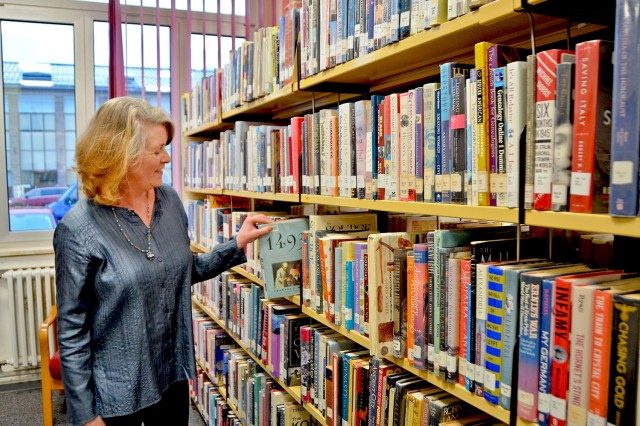 The author shows off some of her favorite U.S. history books at the Wiesbaden Library.