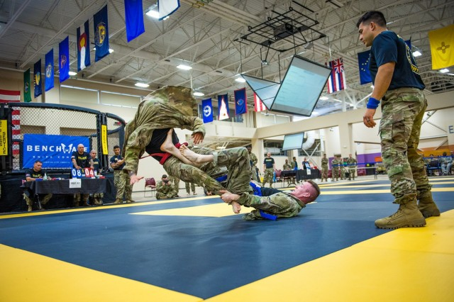 FORT BENNING, Ga. -- In an April 2019 photo, hand-to-hand fighting skills are put to the test during the All Army Lacerda Cup Combatives Competition, held at Fort Benning as part of last year's Infantry Week. The prestigious Infantry Week will be held again this year, from April 14-20. It comprises four separate competitions: Best Mortar Competition, All Army Lacerda Cup Combatives Competition, International Sniper Competition, and Best Ranger Competition. The combatives competition is named in honor of the late Staff. Sgt. Pedro Lacerda of the 75th Ranger Regiment, and recognizes outstanding performance in hand-to-hand fighting skills known in the Army as combatives. Infantry Week is known for its exacting standards and often grueling physical demands, in which competitors vie under high-pressure, combat-like conditions for best-in-their-field honors. The public is invited to attend.