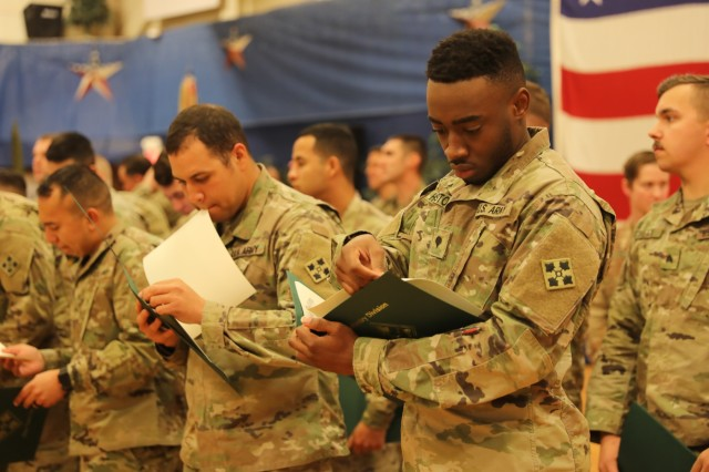 Mass re-enlistment: Soldiers reaffirm commitment