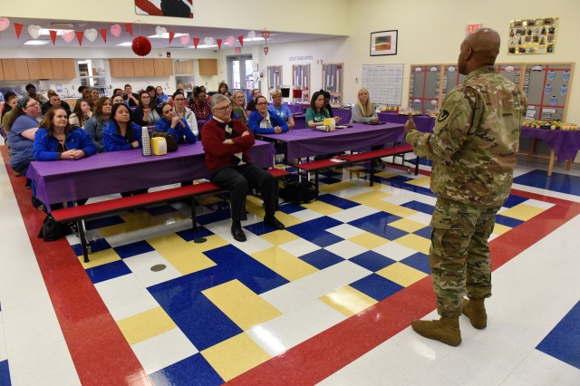 "Command Sgt. Maj. Garrick Griffin, senior enlisted advisor for U.S. Army Garrison at Fort Knox, calls the staff at the Donna Kirby School Age Center ""Soldiers"" for their tireless dedication to taking care of installation personnel and residents' children."