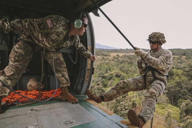 An Army UH-60 Black Hawk flight crew supports the validation of air assault instructors at Schofield Barracks, Hawaii, Jan. 31, 2020.