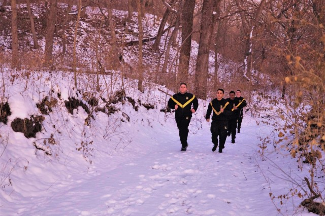 Soldiers with the 1st Infantry Division run on the Moon Lake Fitness Trail at Fort Riley, Kansas. The trail recently reopened to the public after a brief period of renovations. (U.S. Army photo by Pfc. Jared Simmons) (Photo edited to emphasize subjects)