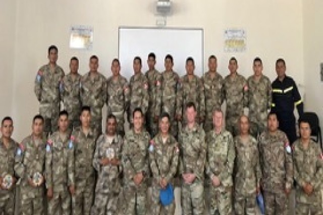 Participants in the West Virginia Army National Guard (WVARNG)- Peru subject matter expert exchange for wheeled vehicle maintenance pose for a photo upon the completion of training Jan. 17, 2020, in Lima, Peru. WVARNG Soldiers conduct ed the second round of light wheeled vehicle mechanic training with Peru's armed forces Jan. 8-17, 2020, in Lima, Peru, as a part of the Department of State's Global Peace Operations Initiative (GPOI) and the National Guard Bureau's State Partnership Program (SPP).