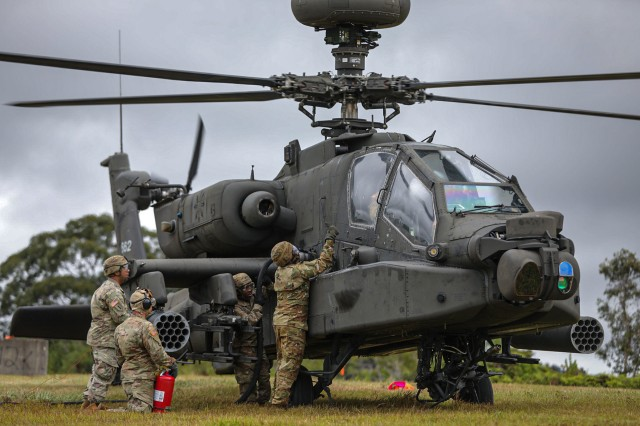 Petroleum Supply Specialists assigned to Echo Co. from 2nd Battalion, 25th Aviation Regiment and 3rd Battalion, 25th Aviation Regiment, work together to refuel three Black hawks and an Apache attack helicopter from 2-6 Cavalry Squadron, 25th Combat Aviation Brigade during training in Forward Area Refueling Point (FARP) procedures at Schofield Barracks, Hawaii Feb. 5, 2020. Soldiers were trained on the proper procedures and execution of establishing a Jump FARP while utilizing the CH-47F Chinook helicopter from B. Co, 3rd Battalion, 25th Aviation Regiment.