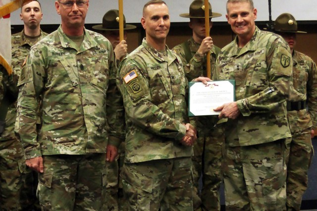 From left, Air Defense Artillery School Command Sgt. Maj. Stephen Burnley stands with Col. Mark Holler, outgoing ADA School commandant and ADA branch chief. Holler received the Legion of Merit from Maj. Gen. Wilson A. Shoffner, Fires Center of Excellence and Fort Sill commanding general, during a retreat ceremony Feb. 3, 2020.