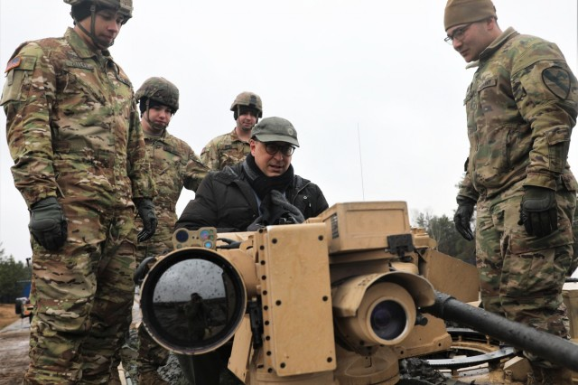Soldiers with the 1st Battalion, 9th Cavalry Regiment from Fort Hood, Texas and multinational partner forces engage in a Combined Arms Live Fire Exercise (CALFEX) attended by the U.S. Emassador to Lithuania, Robert Gilchrist, on Feb. 12, 2020. (U.S. Army National Guard photo by Staff Sgt. Gregory Stevens)