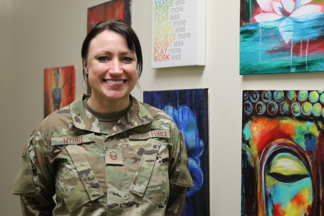 Master Sgt. Kathleen Myhre, 446th Airlift Wing Airman and Family Readiness Center noncommissioned officer in charge, showcases her artwork Feb. 12.