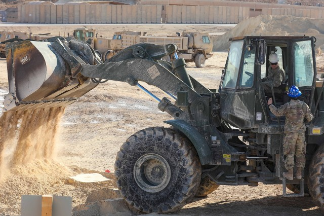 Soldiers with the South Carolina Army National Guard's 124th Engineer Company, attached to the 206th Engineer Battalion, operate a front-end loader at Al Asad Air Base, Iraq, Jan. 23, 2020. The crew fortified defenses after a ballistic missile attack.