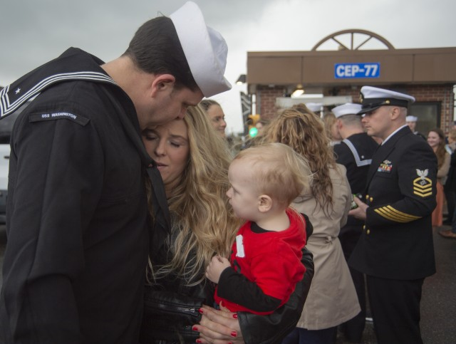 A sailor assigned to the Virginia-class, fast-attack submarine USS Washington greets his family at Naval Station Norfolk, Va., after a deployment, Feb. 11, 2020.