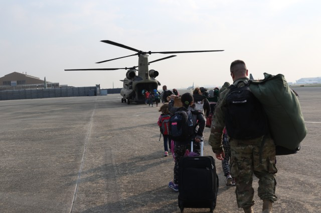 Family members representing installations and commands throughout US Forces Korea board a CH-47 Chinook Helicopter Daegu Air Base, Republic of Korea, Nov. 3, 2016, for noncombatant exercise Courageous Channel.