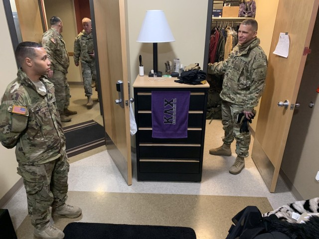 Sgt. Maj. of the Army Michael A. Grinston (right) checks in on a Soldier's barracks room during a visit to Alaska on Jan. 28. Grinston encourages sergeants to regularly check in on the personal lives of their Soldiers, including their living quarters, to ensure they are taken care of.