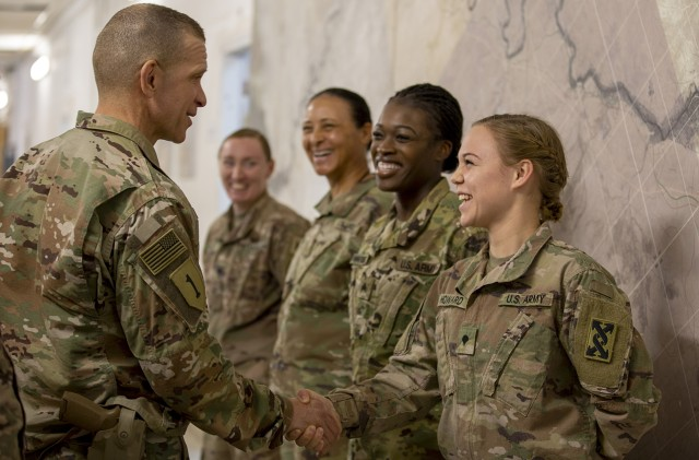 Sgt. Maj. of the Army Michael A. Grinston greets Soldiers deployed to Al Asad Air Base, Iraq, Dec. 19, 2019. Since August 2019, Grinston has tasked young NCOs to lead the culture change in order to create more cohesive, fit and lethal squads across the Army.
