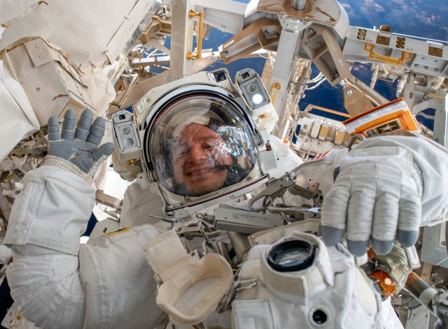 Col. Drew Morgan waves as he is photographed during a spacewalk to repair the Alpha Magnetic Spectrometer, a cosmic particle detector on the International Space Station, Nov. 15, 2019. The Army is currently accepting applications from Soldiers interested in being the next astronaut.