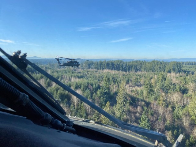 2-158 AHB Drops in SOF Soldiers During Training Exercise at JBLM