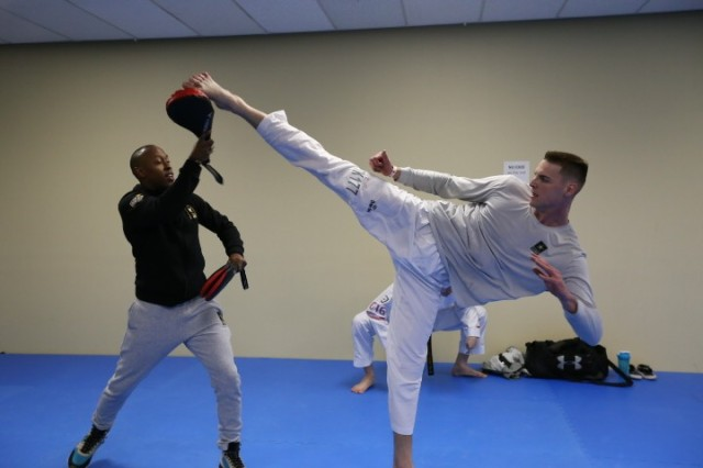 Pfc. Russell Gresham practices a hook kick with World Class Athlete Assistant Coach Terrence Jennings.