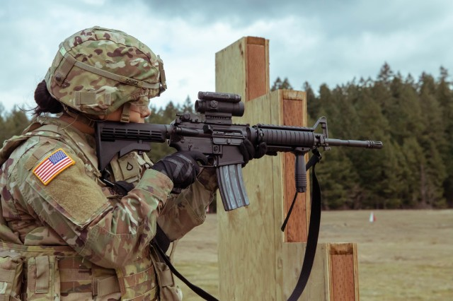 Pfc. Joanna Gaona Gomez begins the Army's new weapons qualification test in the standing unsupported position before dropping to prone unsupported at Joint Base Lewis-McChord, Washington, March 3, 2020. After moving to the prone unsupported and supported positions, Soldiers use a barricade and have approximately nine seconds to change magazines and positions. (U.S. Army photo by Pfc. Laurie Ellen Schubert)