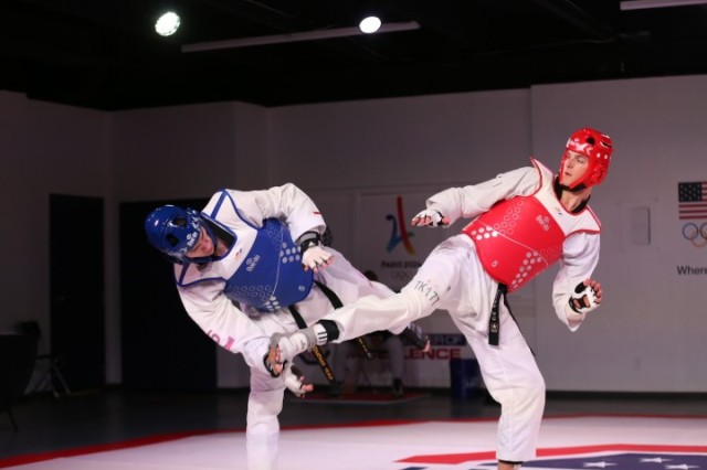 Pfc. Russell Gresham lands a kick against U.S. No.1 Jonathan Healy in the semifinals of the 2020 Poomsae Grand Slam Final in Colorado Springs. Gresham defeated Healy for the first time, 13-5. Gresham is currently ranked No. 3 in the U.S. at heavyweight.