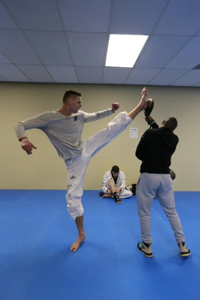 Pfc. Russell Gresham practices his kicks with WSCAP Taekwondo assistant coach Terrence Jennings during the 2020 Poomsae Grand Slam held at Colorado Springs in January. The 7-foot Gresham competed on the basketball court most of his life before taking up Taekwondo after college.