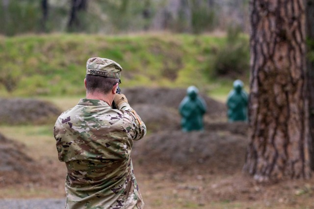 Lt. Col. Christopher Osgood, military intelligence staff officer with Headquarters Support Company, Headquarters and Headquarters Battalion, I Corps, begins the new M9 pistol qualification while in the standing position at Joint Base Lewis-McChord, Washington, March 3, 2020. The M9 pistol qualification involves a standing portion, then kneeling and finishes with a walking engagement toward the targets. (U.S. Army photo by Pfc. Laurie Ellen Schubert)
