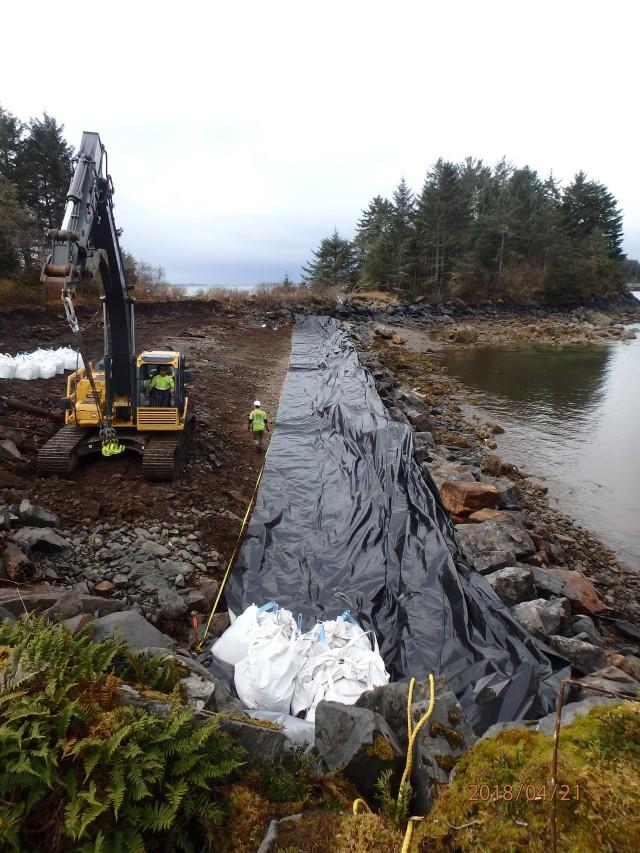 Placing D1 gravel bags on plastic sheeting along D1 bag footprint at Virublennoi_Landfill - South