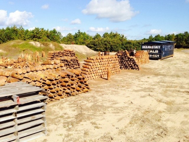 The IAGWSP has identified and destroyed over 1,591 UXOs, recovered more than 8,877 UXO Like anomalies.  Photo of the IAGWSP staging area before they perform the required 2nd and final Safety certification for each piece of munitions related scrap, so that it can be recycled.