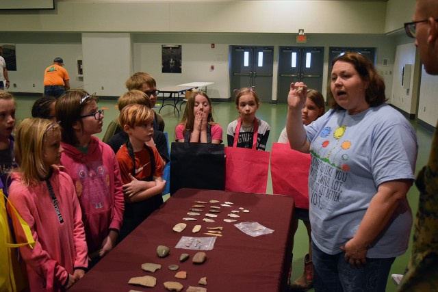 Stephanie Nutt, Directorate of Public Works cultural resource coordinator, shows archaeological artifacts to students at the 2019 Earth Day Fair. In February, DPW's environmental and cultural resource management programs won two Secretary of the Army Environmental awards.