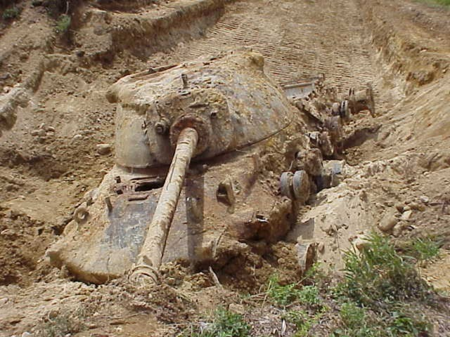 The IAGWSP has excavated 56,087 anomalies, photo shows a very large anomaly, a T60 Tank, that was buried by DoD contractors on one of one of the testing ranges in Camp Edwards CIA.  The tank was recovered, utilizing soldiers and an M88, the tank was moved to a consolidation area within the CIA.