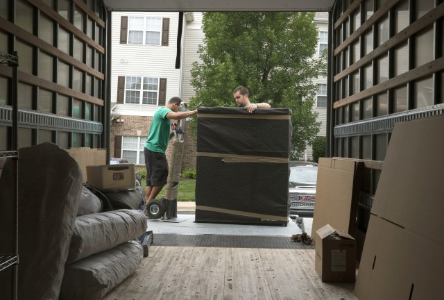 Movers pack up the households goods of a Soldier June 12, 2019. Soldiers preparing for a permanent change-of-station move can now request to stay at their current duty station for up to a year, as the Army adapts how it moves people during the COVID-19 crisis.