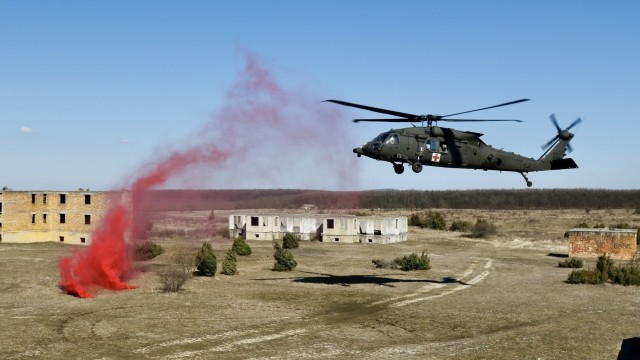 A MEDEVAC helicopter from 2-3 General Support Battalion, 3rd Combat Aviation Brigade, 3rd Infantry Division, prepares for landing during Hawk Strike in Hungary on March 5. Hawk Strike allows units to conduct movements in a realistic, high-intensity environment to ensure readiness and the ability to fully integrate with any NATO partner and ally, such as the Hungarian Forces.